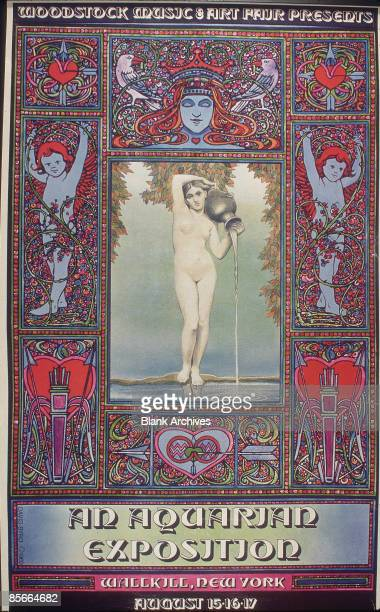 View of the original poster for the Woodstock Festival 'An Aquarian Exposition' 1969 The poster gives the event's original location of Wallkill New...