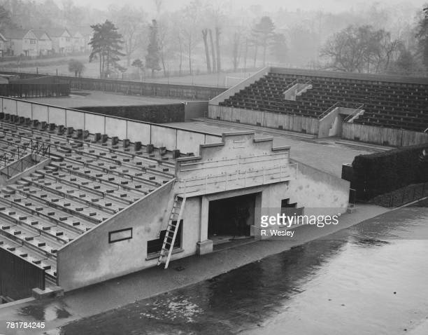 A view of the outside grandstands and courts and the tunnel entrance on the east side of the Centre Court on 6 December 1934 at the All England Lawn...