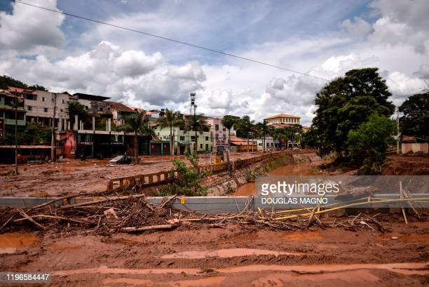 View of the overflowing Das Velhas River in Sabara, Belo Horizonte, Minas Gerais state, Brazil, on January 26 after heavy rains. - At least 30 people...
