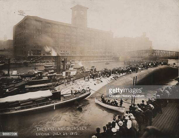 View of the overturned SS Eastland, a passenger tour ship that rolled over while docked on the Chicago River, Chicago, July 1915. 844 passengers and...