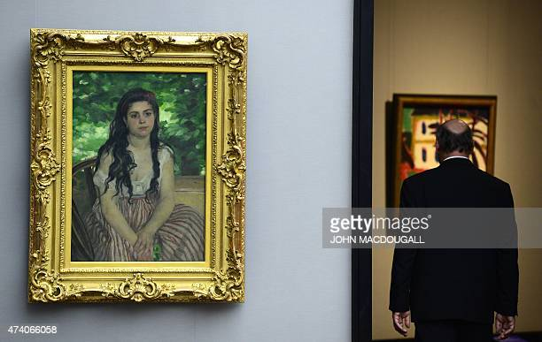View of the painting In Summer by French painter Auguste Renoir during a press preview of the ImEx exhibition at Berlin's Alte Nationalgalerie on May...
