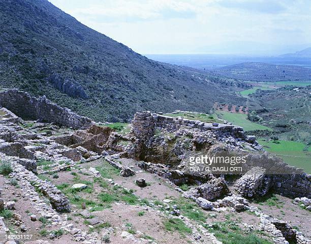 View of the palace and walls of The Acropolis with the Gulf of Argos in the background Mycenae Greece Mycenaean civilization 13th14th Century BC