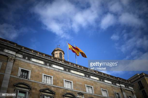 A view of the Palau Catalan Regional Government Build with Spanish and Catalan flags flying on October 28 2017 in BarcelonaSpain The Spanish...