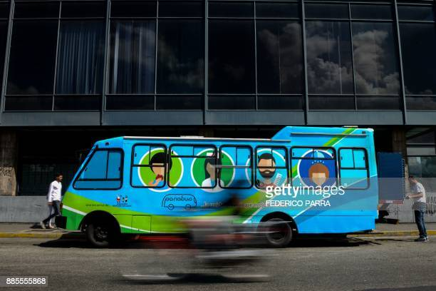 View of the PanaBus parked on the street in Caracas on November 27, 2017. Monday through Friday, the PanaBus makes its way around the Venezuelan...