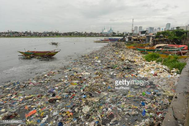A view of the paper plastic and other garbage in the Pasig River seen from a costal road in Baseco Compound in Manila The Batangas Shipping and...