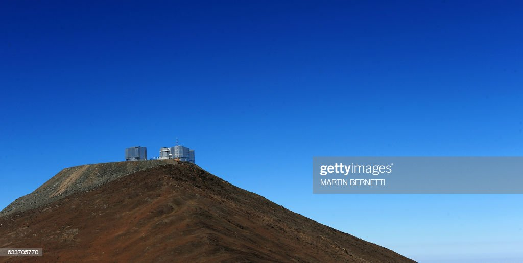 View of the Paranal hill where the European Southern Observatory (ESO) sits, on September 16, 2008 in Paranal, some 1150 km north of Santiago, Chile. Chile won the right April 26, 2010 to host the largest-ever telescope, the Munich-based European Southern Observatory (ESO) said, calling the planned facility 'the world's biggest eye in the sky'. The new observatory will be built atop the Armazones hill, near the ESO. AFP PHOTO/Martin Bernetti /