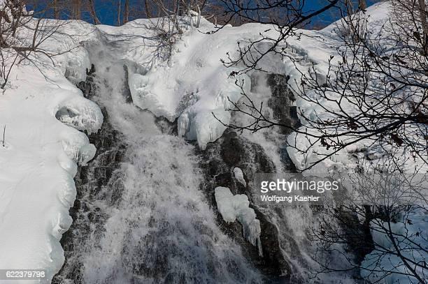 View of the partially frozen Oshinkoshin Waterfall in the winter in Abashiri Shiretoko National Park Shiretoko Peninsula on Hokkaido Island Japan