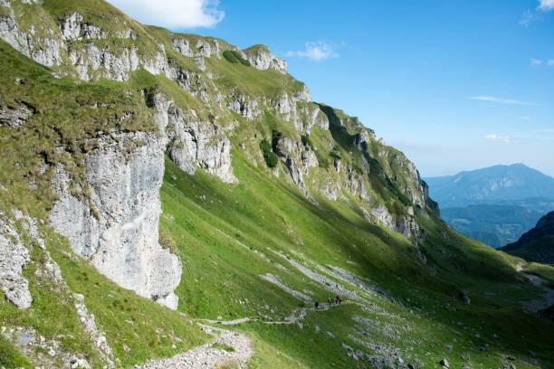 View of the path to  Omu peak with people on ascending near Malaiesti hut, Bucegi mountains, Romania