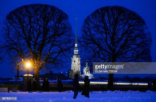 TOPSHOT A view of the Peter and Paul Fortress before the lights are turned off for the Earth Hour environmental campaign in Saint Petersburg on March...