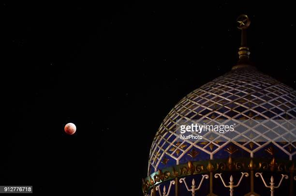 A view of the phenomenon of lunar eclipse in Lhokseumawe Aceh Province Indonesia on January 31 2018 A rare lunar eclipse is called the quotSuper Blue...