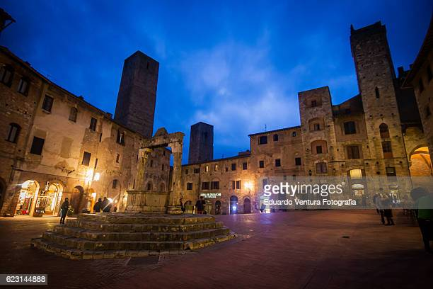 View of the Piazza della Cisterna in San Gimignano, Italy at blue hour