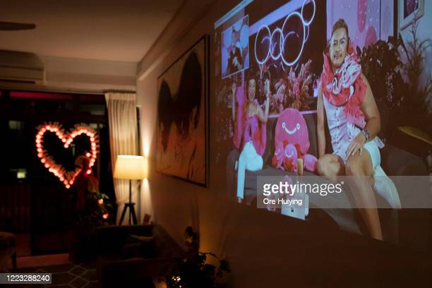 A view of the Pink Dot SG rally livestream projected on a wall in a house on June 27 2020 in Singapore Due to the ongoing coronavirus pandemic this...