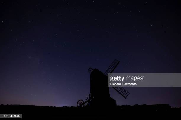 View of the Pitstone Windmill and the stars of the night sky on May 20, 2020 in Pitstone, England.