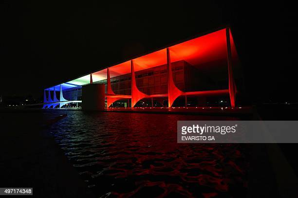 View of the Planalto Palace illuminated in the colors of the French flag in Brasilia on November 14 a day after deadly terrorist attacks in Paris A...