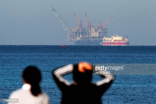 View of the platform of the Leviathan natural gas field in the Mediterranean Sea is pictured from the Israeli northern coastal city of Caesarea on...