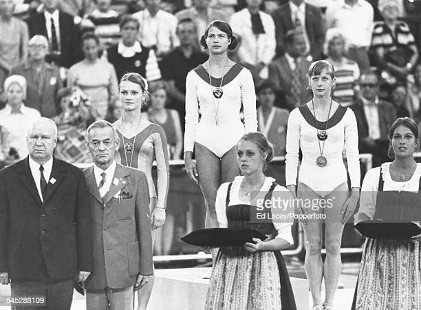 View of the podium and medal winners for the Women's artistic individual allaround gymnastics competition silver medal winner Karin Janz of German...
