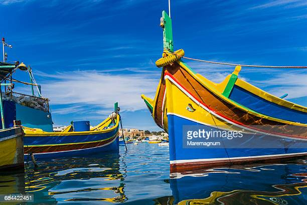 view of the port with the typical boats - marsaxlokk stock pictures, royalty-free photos & images