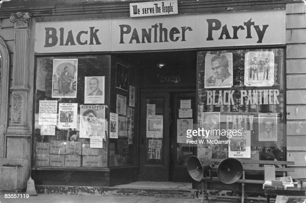 View of the poster-filled windows of the storefront headquarters of the Black Panther Party in Harlem, New York, New York, September 21, 1969.