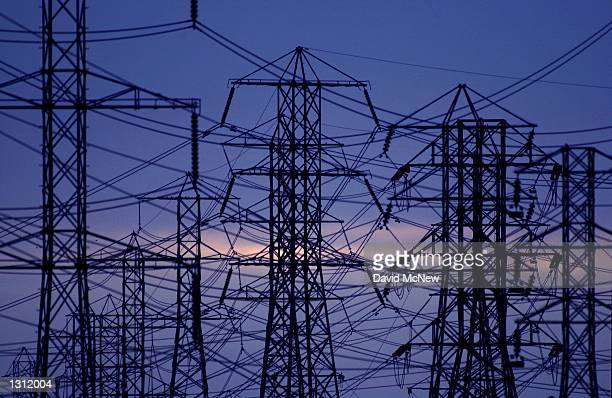 View of the power lines as evening settles December 11, 2000 in Pico Rivera, CA. California residents statewide are urged to delay turning on their...
