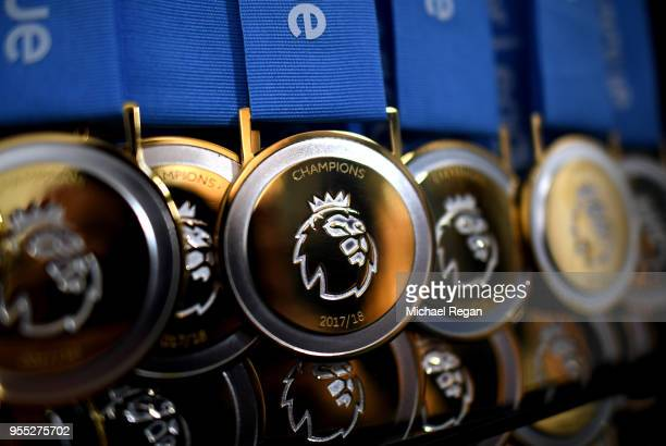 A view of the premier league winners medals prior to the Premier League match between Manchester City and Huddersfield Town at Etihad Stadium on May...