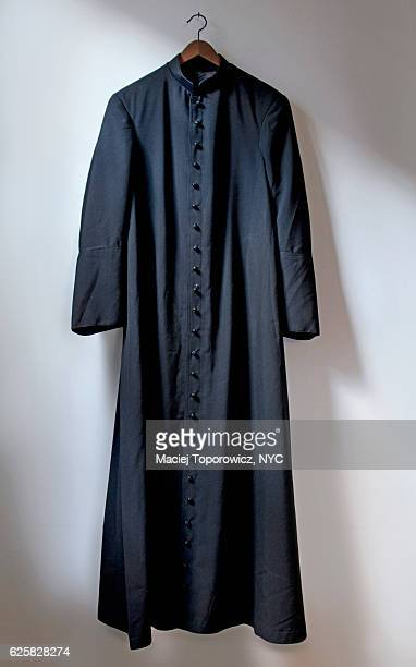 view of the priest robe hanging on a wall. - catolicismo fotografías e imágenes de stock