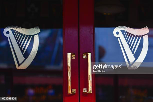 A view of the pub entrance with two Guinness logos seen in Dublin city center On Wednesday March 15 in Dublin Ireland