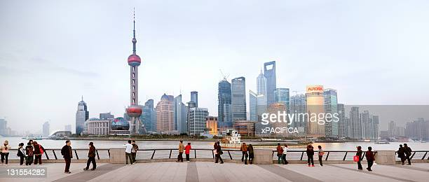 A view of the Pudong skyline with tourist.