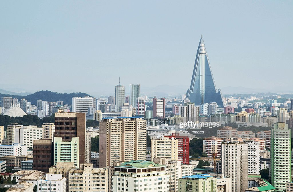A view of the Pyongyang cityscape, looking towards the Ryugyong Hotel Tower from Yanggakdo Hotel on August 24, 2015 in Pyongyang, North Korea. North and South Korea today came to an agreement to ease tensions following an exchange of artillery fire at the demilitarized border last week.