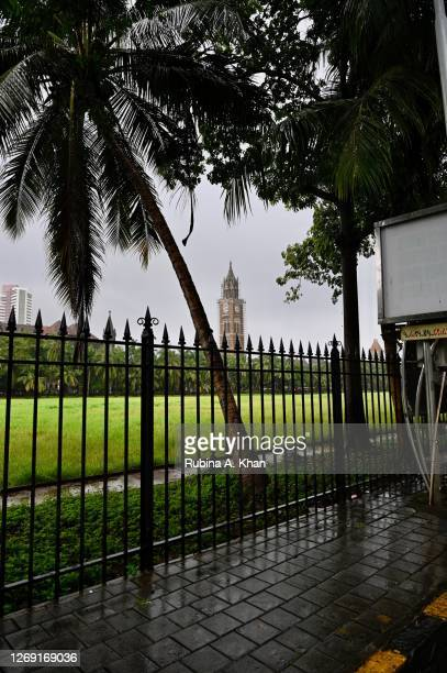 View of the Rajabai Clock Tower, built in 1878, across the Oval Maidan from the Green Fields art deco building on August 21, 2020 in Mumbai, India.