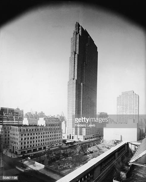 View of the RCA Building in the Rockefeller Center complex, New York, New York, early 1930s. The constuction pit in the foreground was for the...