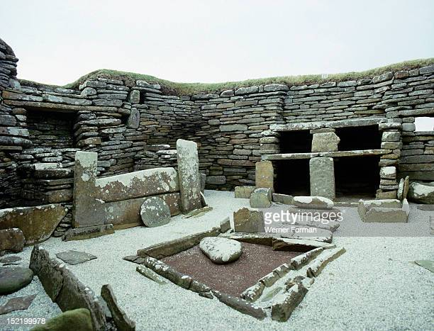 View of the rectangular central hearth and the massive stone built version of the old 'farmhouse dresser' situated opposite the entrance of the House...