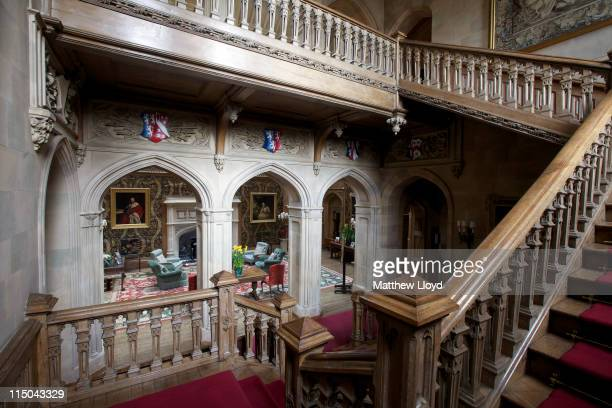 View of the red staircase in Highclere Castle on March 15, 2011 in Newbury, England. Highclere Castle has been the ancestral home of the Carnarvon...