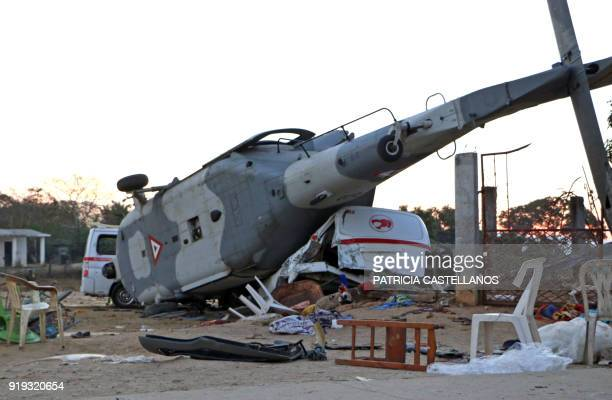 TOPSHOT View of the remains of the military helicopter that fell on a van in Santiago Jamiltepec Oaxaca state Mexico on February 17 2018 A...