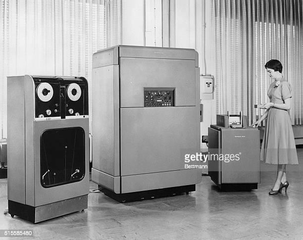 View of the RemingtonRand calculating machine UNIVAC an early computer originally developed for the US Census Bureau Photo shows woman standing next...