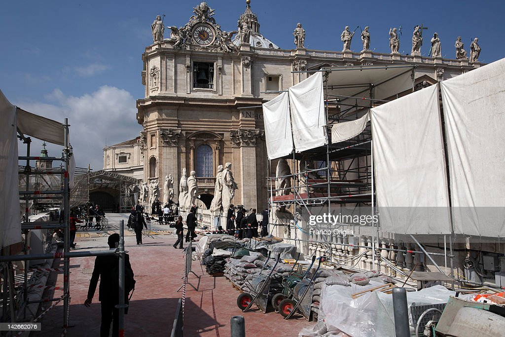 A view of the restoration works of the colonnade of Gian Lorenzo Bernini in St. Peter's Square during Palm Sunday Mass on April 01, 2012 in Vatican City, Vatican. The square was designed by architect Gian Lorenzo Bernini in 1656. The two semi-circles of the colonnade are surrounded by 140 statues and 244 columns. Guy Devreux of the Vatican Laboratory for Marble and Cast began direction of the works in 2009.