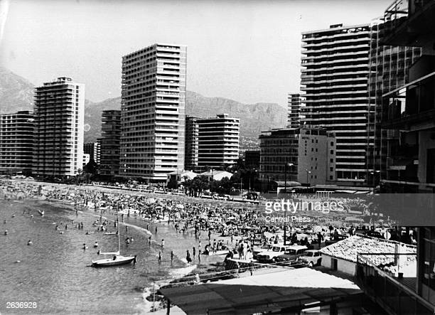 A view of the Rincon de Loix Corner of Loix Benidorm with its beach already full of swimmers