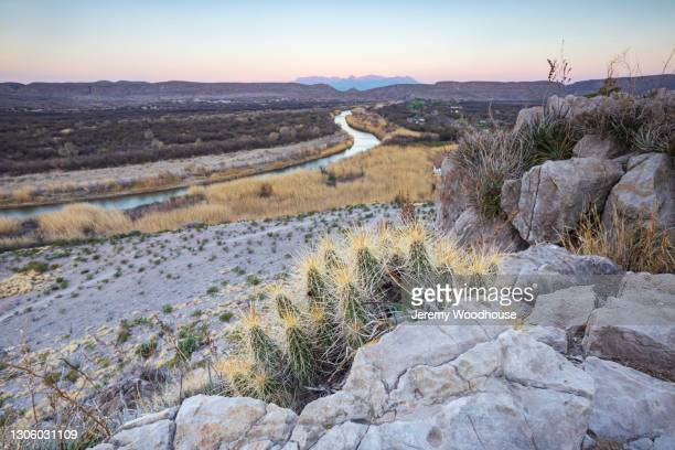 view of the rio grande and the chisos mountains at sunrise - chisos mountains stock pictures, royalty-free photos & images