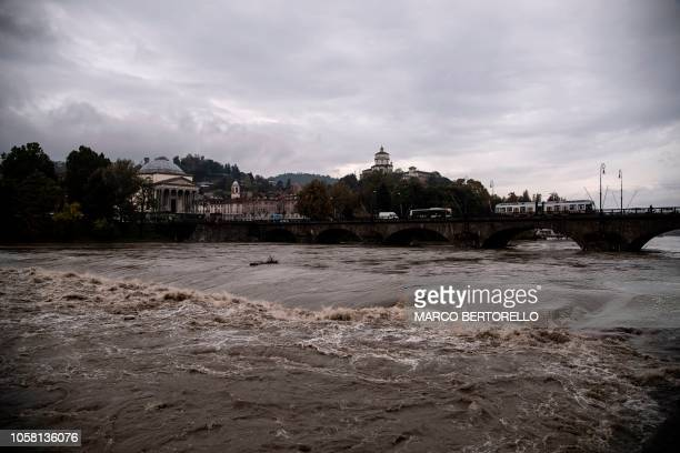 View of the river Po in the city center of Turin on November 6, 2018 after its level rose overnight following heavy rain. - Heavy rains continued to...