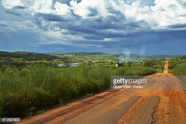 A view of the road linking the village to the diamond mine with a workers settlement on the left and clouds indicating the rain season 27 March 2013...