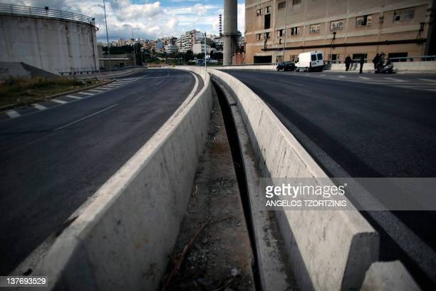 View of the road where Greek film director Theo Angelopoulos died following a road accident in Athens on January 25 2012 Greek film director Theo...