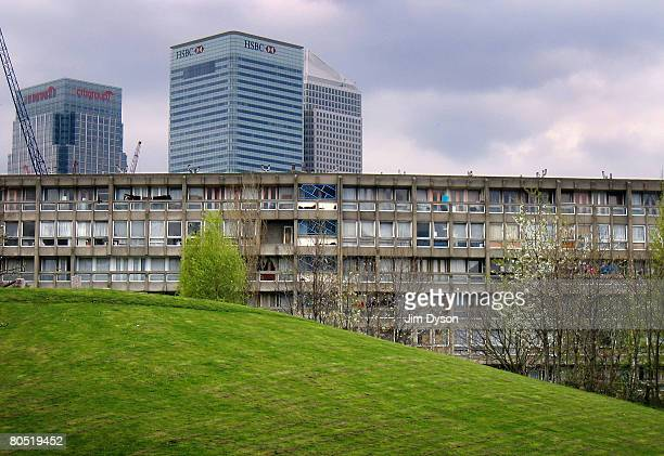 A view of the 'Robin Hood Gardens' housing estate in Poplar with the skyscrapers of Canary Wharf in the background on April 3 2008 in East London...