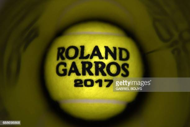 TOPSHOT View of the Roland Garros 2017 ball ahead of the Roland Garros 2017 French Tennis Open on May 26 2017 in Paris / AFP PHOTO / GABRIEL BOUYS