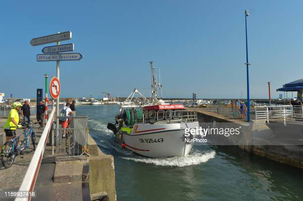 A view of 'The Rolling Stones' fishing boat leaving PortenBessin harbour On Friday August 2 in Caen Normandy France