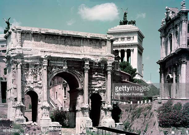View of the Roman Forum Italy Lazio Rome Detail On the right the Arch of Septimius Severus 202203 3rd Century bC 23 x 25 x 1185 m marble on the left...