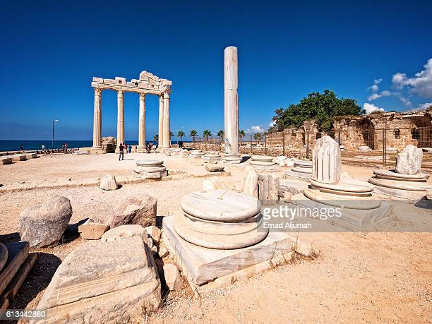 view of the roman ruins of the temple of apollo in side on the turquoise coast of antalya province, turkey - antalya stock-fotos und bilder