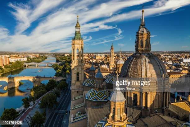 view of the roofs and spires of basilica of our lady in zaragoza, spain - アラゴン ストックフォトと画像