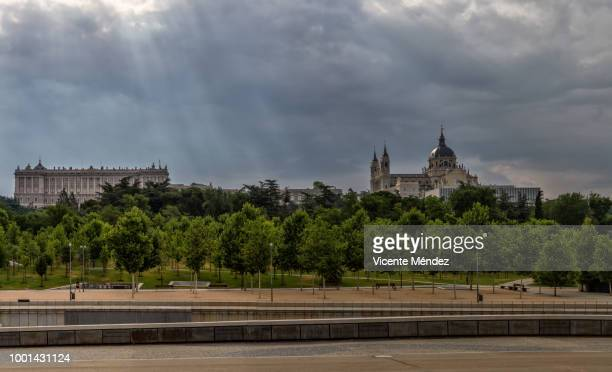 view of the royal palace and the cathedral of la almudena - royal cathedral stock pictures, royalty-free photos & images