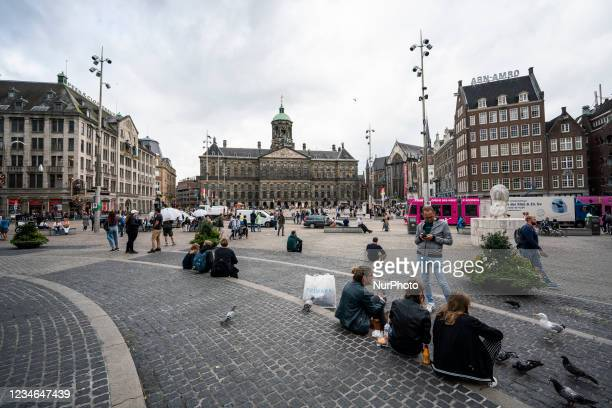 View of the Royal Palace on Dam square in Amsterdam, Netherlands, on August 6, 2021. Its remarkable buildings and its frequent events make it one of...