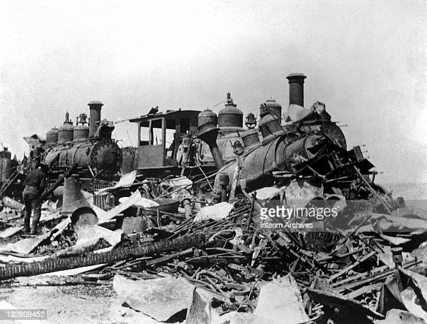 View of the ruins of Spanish locomotives burned and destroyed during the American invasion of the town of Daiquiri, Cuba, during the Spanish American...