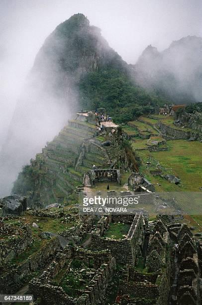 View of the ruins of the Inca city of Machu Picchu low clouds Urubamba Valley Peru Inca civilisation 15th century